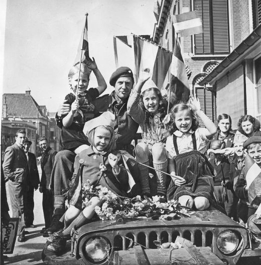 Netherlands liberation.  Those kids were pretty happy to see the Canadian soldiers.