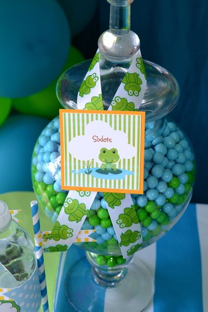 Sixlets in a glass jar at a Frog Party.  See more party ideas at CatchMyParty.com. #frogpartyideas