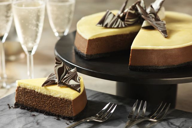 Chocolate and vanilla come together as a perfect pairing in this gorgeous layered cheesecake - the perfect dessert for impressing a crowd.