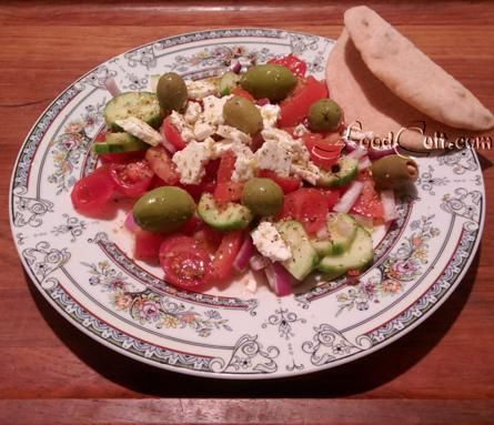 #GreekSalad in an instant ... and a piece of #organic, #homemade light #WholeWheat #pita. Satisfying, #healthy and delivers a nice serving of #OliveOil, #tomatoes and #feta #cheese. An amazing #snack in under 10 minutes. #Recipes @ http://www.foodcult.com