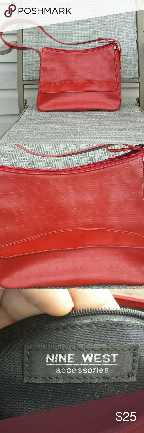 Nine West Purse Beautiful Red Nine West Purse. Liner completely in tact, no damage to the inside. A tiny scuff mark pictured. Nine West Bags