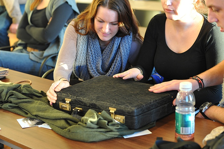 Students at our Wildlife Crime event checking a briefcase which was confiscated at Amsterdam Schiphol Airport. Stop wildlife crime - just don't buy it!