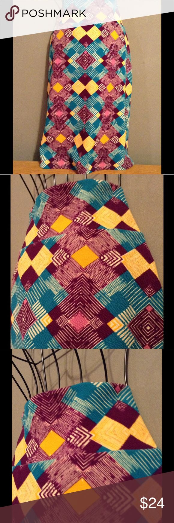 NWOT LLR Cassie Skirt Never worn. Gorgeous pattern with vibrant colors. NWOT and a total steal! LuLaRoe Skirts Midi
