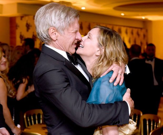 Harrison Ford smooched wife Calista Flockhart at the HBO party. The spouses held hands and stayed by each other's sides all night <3 See more Golden Globes afterparty pics here!