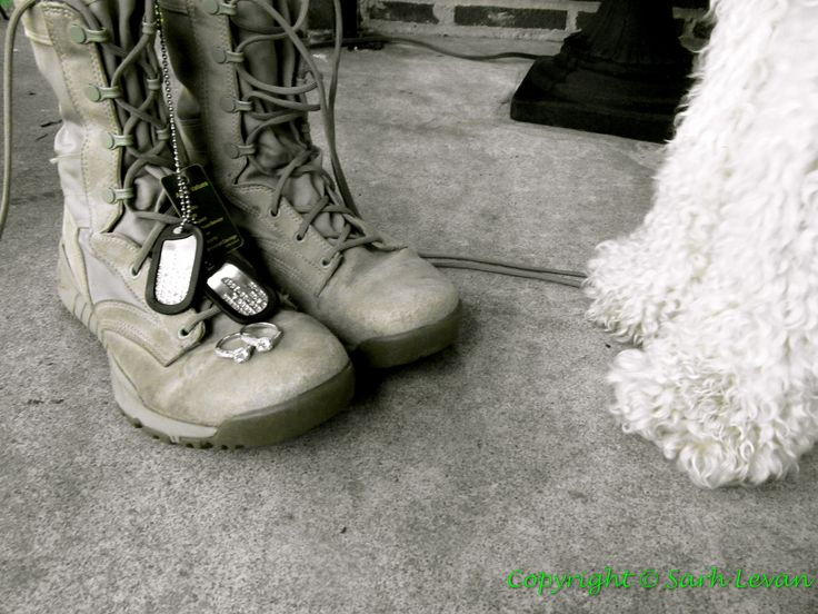 Doggy Paws & Combat Boots- I took this picture of my fiancees dog tags and her combat boots shortly after we had both received our engagement rings. We wanted a picture of just the boots and rings, but our Goldendoodle puppy wanted to compare his paws to his Ma's boots mid picture and I captured it.  What a cute Army engagement picture that incorporates your dog!