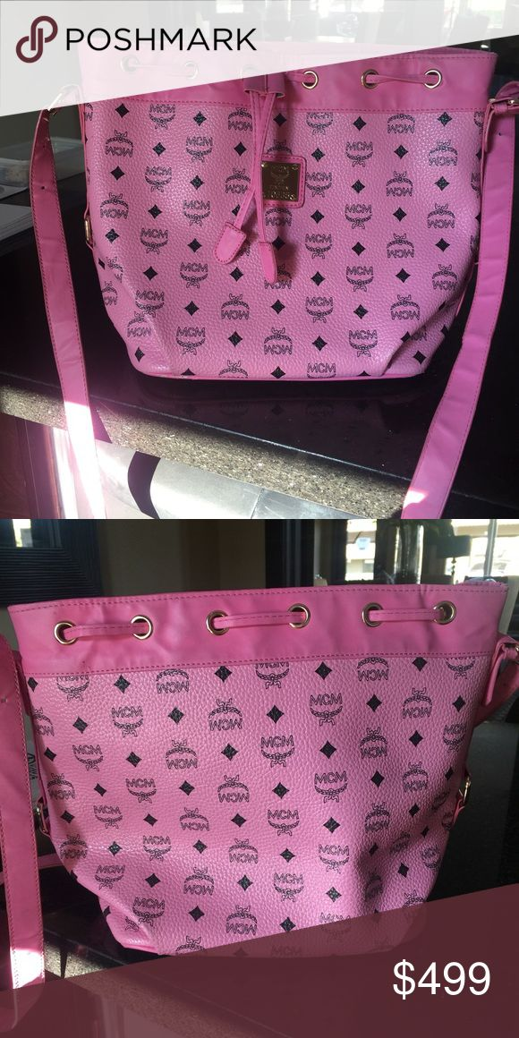 Pink MCM purse Pink MCM purse. It was a gift, wore it twice. Nothing is wrong with it. It's just not my type. MCM Bags Shoulder Bags