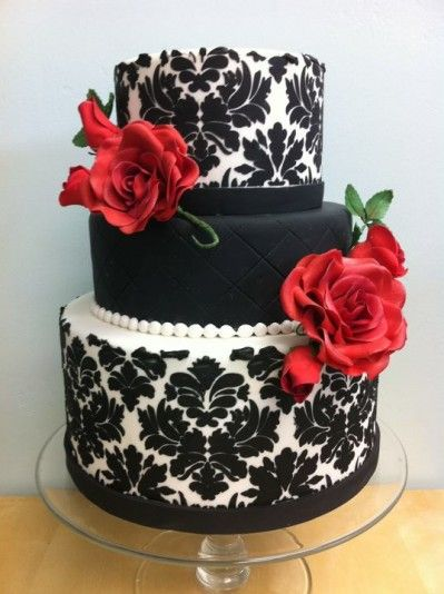 I really like this! Red, black and damask! Perfect! BUT I still like the idea of cupcakes....