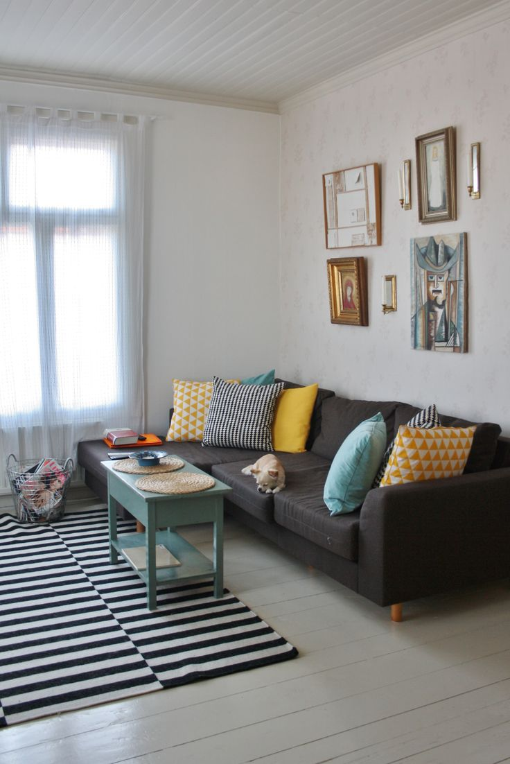 View from the livingroom: old and new, black and white, yellow and mint. Ikea Stockholm rug and a table originally owned by my great-grandaunt.