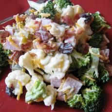 Cauliflower & Broccoli Salad with bacon and cheddar cheese...I've had this with Ramon Noodles crumbled into the salad uncooked...I would also leave out the onion.