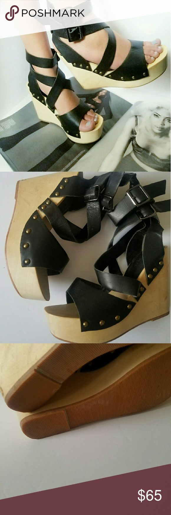 """Chinese laundry wooden wedge platform heel Stand tall with these edgy sandals by Chinese Laundry  Leather upper   Approximately 4 1/4"""" Heel with 1 1/2"""" platform  Like new  *labeled size 8 but fits more like 7- 7 1/2*  Please check out my closet for other fabulous items! Reasonable offers welcome. Chinese Laundry Shoes"""