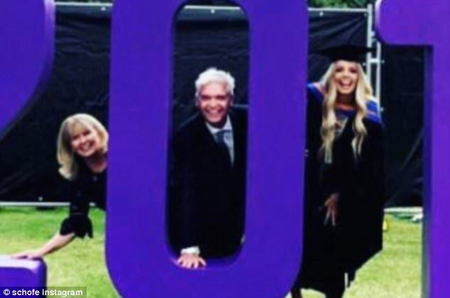 Proud father: Phillip Schofield marked his daughter Ruby's graduation with a fun group photo with her and his wife Stephanie