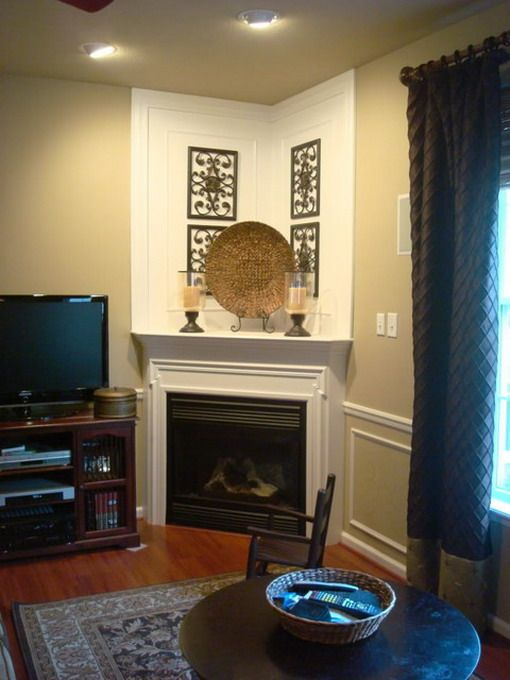 Not my style but it is an example of a corner unit with very little sidewall. I would not recess my fireplace this much. Also, this one does not have a faux chimney area, just a shelf.