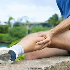Muscle Cramps & Facts & ways to avoid getting cramps. A runner experiencing a muscle cramp in his calf.