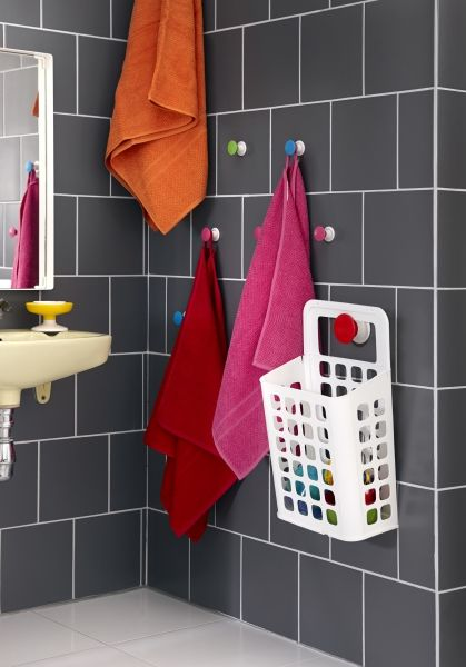 Implement kid-friendly solutions throughout the home to make it easy for you to access what you need. Think about the right height of the solutions so your children can help get themselves ready. The LOSJÖN hanger from IKEA doesn't just bring colors into your bathroom, it can also be placed at children's height.