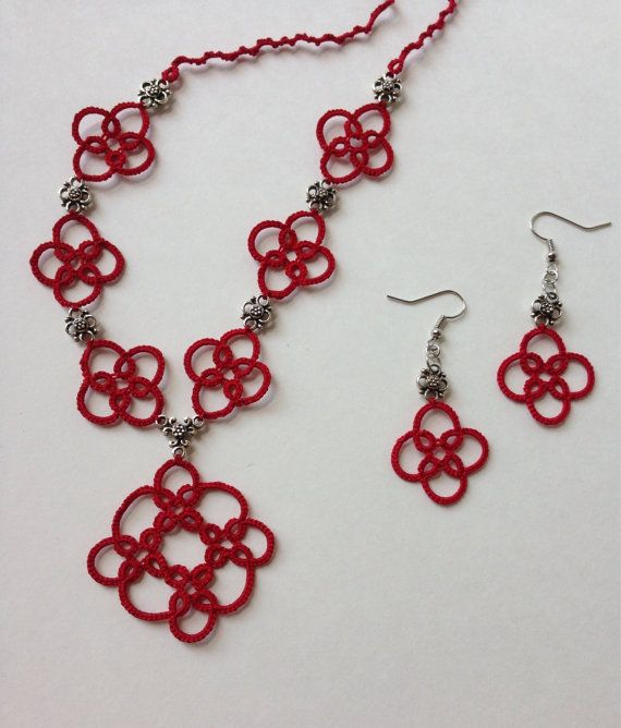 Rose red and silver tatted necklace and earring set I was inspired to tat this piece by Tudor Style. I love the hanging pendant and how the motif