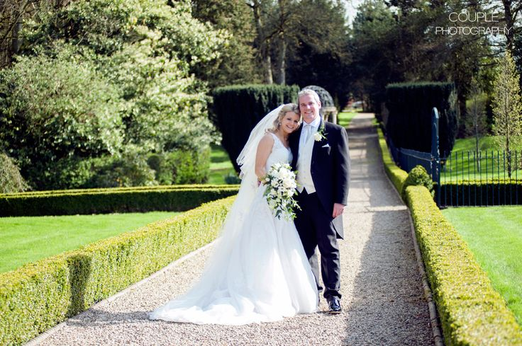 The bride & groom in the greenery of the gardens at Killashee. Weddings at Killashee House Hotel photographed by Couple Photography.