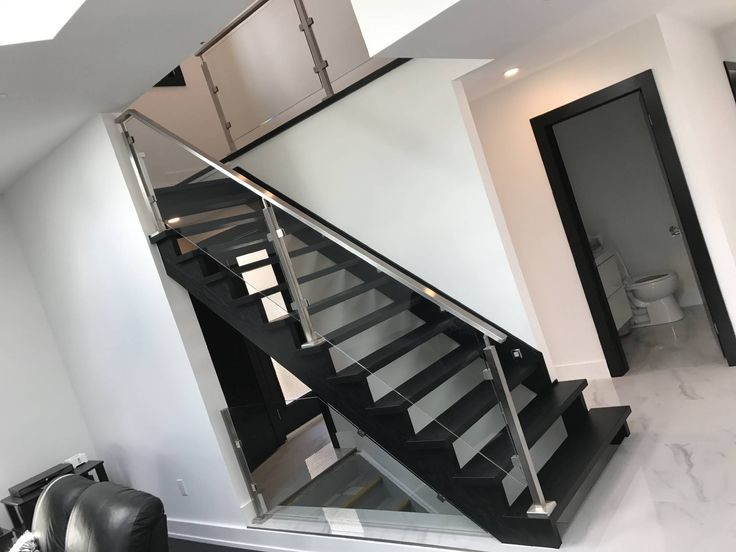 Contemporary oak and glass open staircase in black.