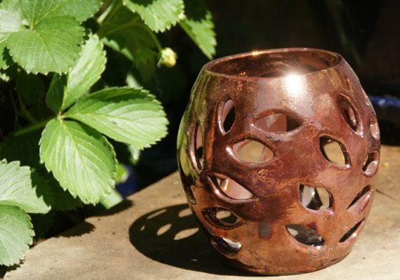 Raku luminary stoneware candle holder with metallic copper glaze, by Diane Waters.