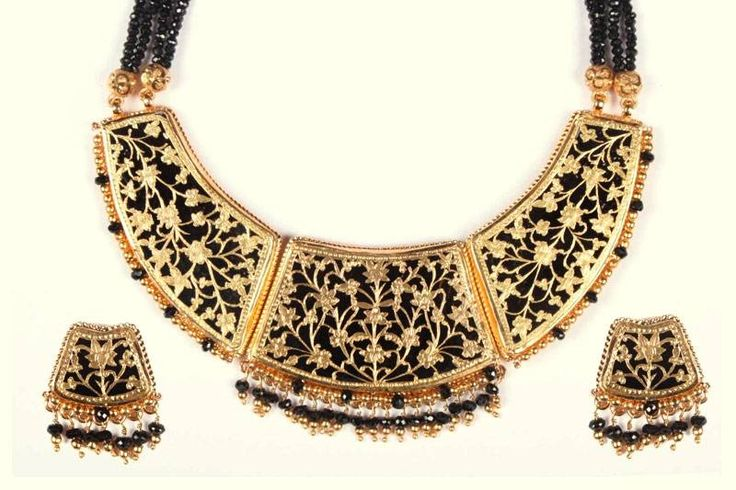 Thewa is a special art of jewelry making which involves embossing of intricately worked-out sheet gold on molten glass. It evolved in Pratapgarh district, Rajasthan India. Its origin dates back to the Mughal age