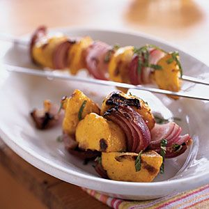 Grilling underscores the earthiness of the cumin and coriander, and enhances the nuttiness of this summer squash. Use white, orange, or yellow pattypan squash for the most colorful skewers.