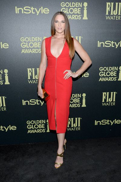 Amanda Righetti wore a red-hot number complete with a plunging deep V-neck, zipper detailing, and midi-slit.