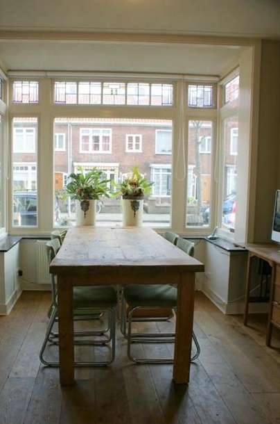 Gorgeous long table with chairs in a Bauhaus / Gispen / De Wit style in a bay window, or in Dutch 'erker'. House in The Netherlands.