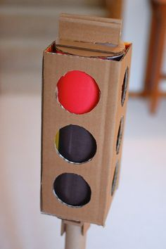make your own traffic light! to go with your cardboard car and cardboard gas station with a pump that actually fits to the car! I love how this women comes up with these ideas!
