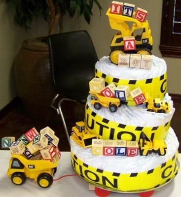 Boy diaper cake: Diaper Your Cake located in Jacksboro, TX was started in October 2010 after three of our friends were having baby showers, all within three weeks of each