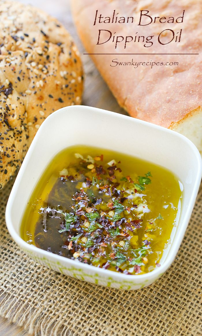 Italian Bread Dipping Oil - It starts with Bellucci EVOO and balsamic vinegar. Fresh parsley, garlic and red pepper flakes make this oil one of my favorites. Finally, it's topped with freshly grated parmesan cheese that really makes this the ultimate savory dip!