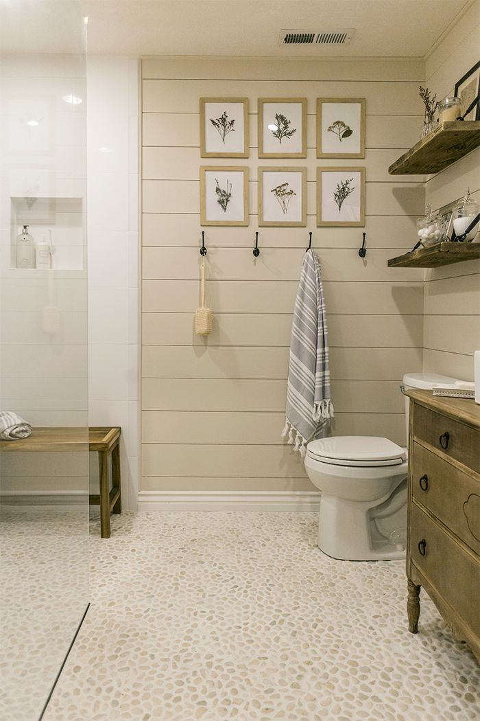 A unique and serene master bath from Jenna Sue Design Co. with Small White Pebbles from The Tile Shop used on the floor and wall!
