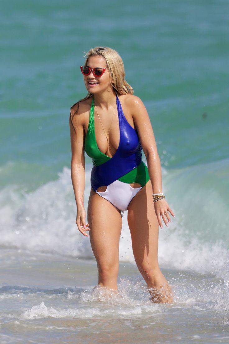 Rita Ora takes a splash in Miami Beach.    - TownandCountryMag.com
