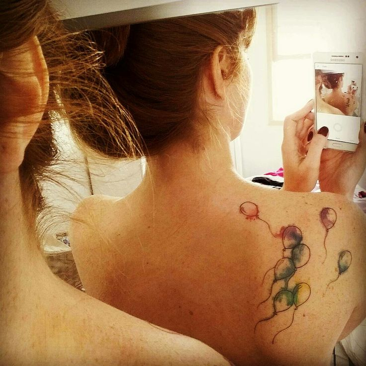 Watercolor balloons tattoo