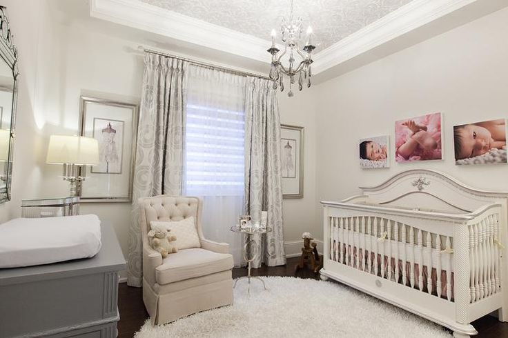 French nursery features a baby photos over a white French