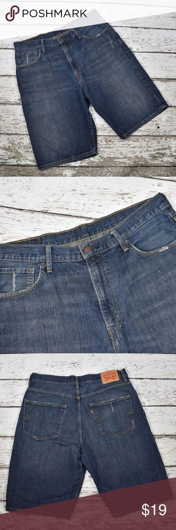 "Levi 569 Men's Jean Dark Denim Shorts Men's Levi 569 denim shorts Size 36 normal wash/wear  measurements laying flat: waist 19"" total length 26"" Levi's Shorts Jean Shorts"