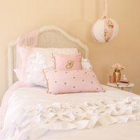 White ruffle quilt with shabby pink accents and lantern