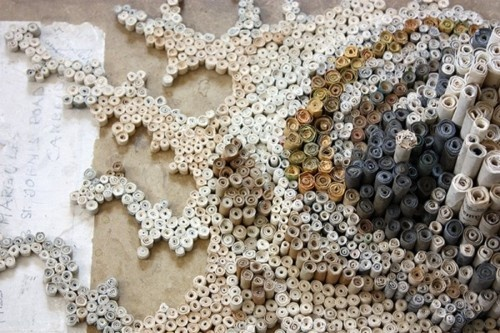 """""""Nava Lubelski creates these cellular sculptures using tightly rolled paper scrolls comprised of tax returns, rejection letters, and other collected waste paper."""