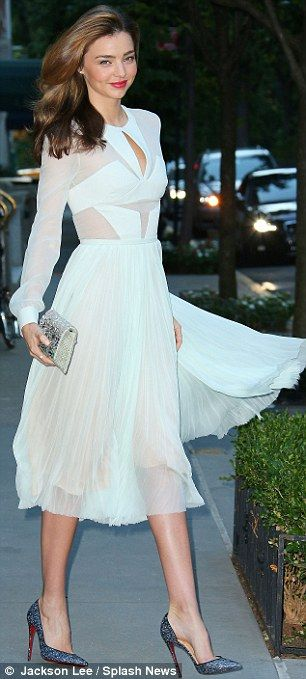 A true heroine: The Australian model teamed her pretty frock with a pair of sparkling heels and a metallic clutch