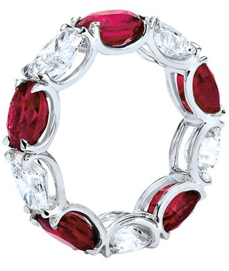 Oval Ruby and Diamond Eternity Band  Oval-shaped rubies and diamonds alternate in a handmade, shared-prong, platinum setting.   Cellini Jewelers