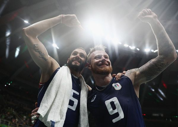 Ivan Zaytsev (R) and Osmany Juantorena of Italy celebrate victory over the United States in the Men's Volleyball Semifinal match on Day 14 of the Rio 2016 Olympic Games at the Maracanazinho on August 19, 2016 in Rio de Janeiro, Brazil.