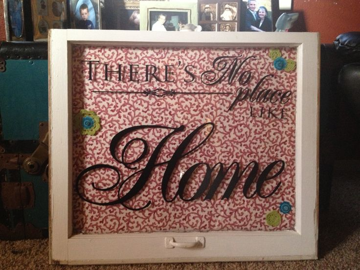 DIY craft. Old window, vinyl letters, poster board covered with ...