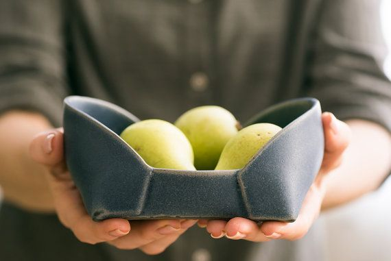 Blue ceramic nesting trays set . made of folded stoneware surface,with an uneven edges that creates a modern unique shape. Glazed with matte dark