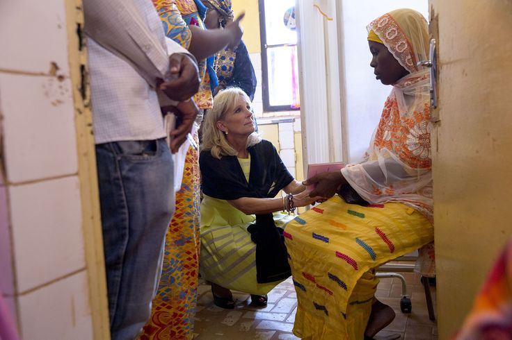 """""""David Lienemann accompanied Second Lady Dr. Jill Biden on her trip to Africa and captured this photograph of her greeting the mother of triplets in the maternity room at the Mary Stopes clinic, a women's health clinic which receives funding from USAID, in Niamey, Niger."""" (Official White House Photo by David Lienemann)"""