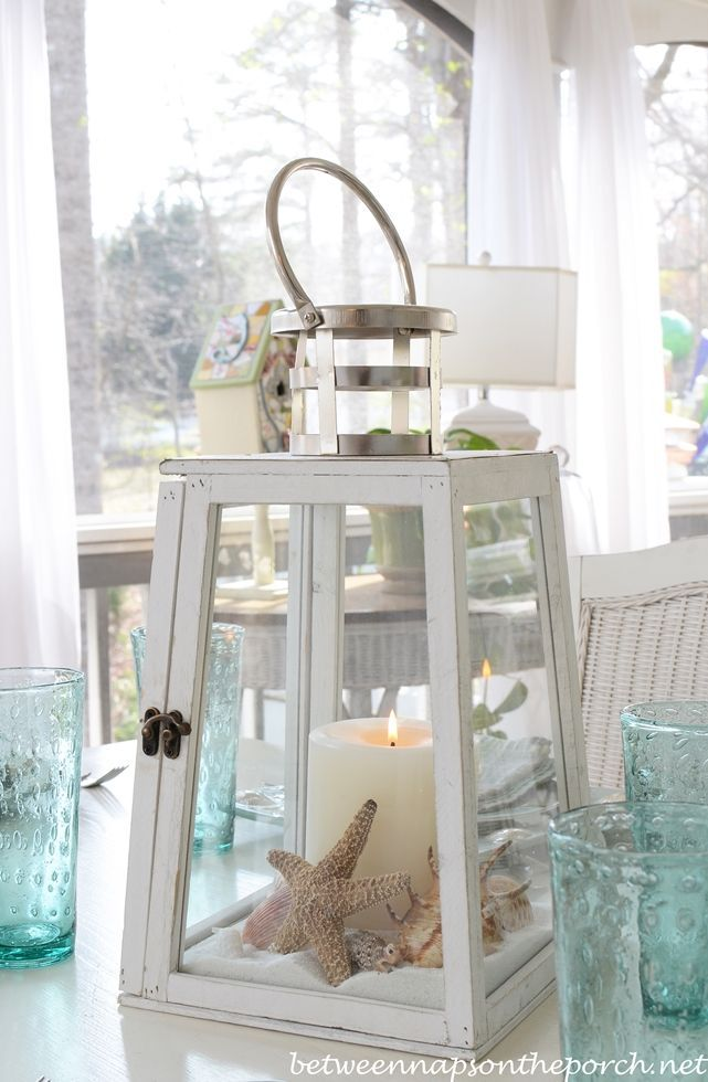 Beach Table Setting : white sand, candle and shells added to lantern centrepiece