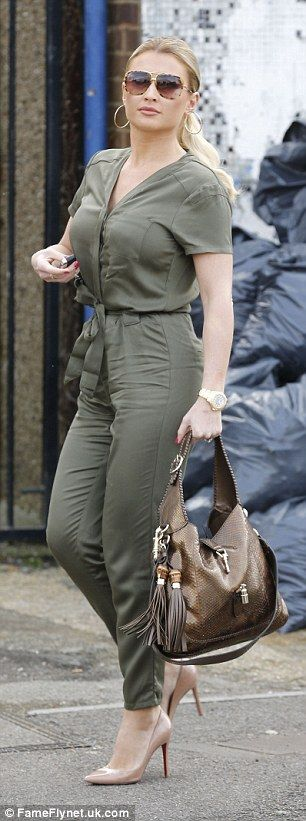 Matching: And matched her glamorous gold watch to a metallic handbag