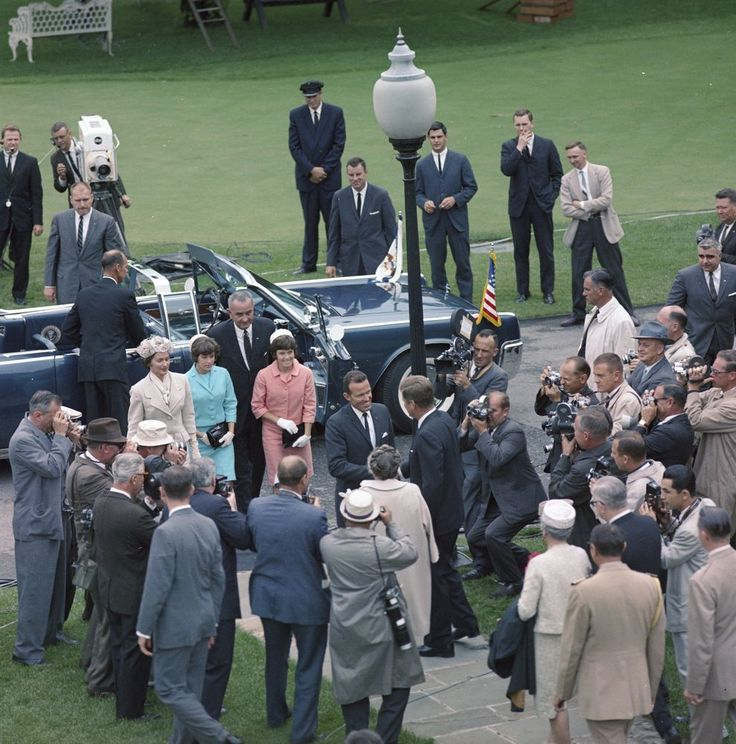 May 21, 1963. President John F. Kennedy (center) greets astronaut Major L. Gordon Cooper and his family upon their arrival at the White House for Major Cooper's National Aeronautics and Space Administration (NASA) Distinguished Service Medal (DSM) presentation ceremony.  South Lawn driveway, White House, Washington, D.C. r - John F. Kennedy Presidential Library & Museum