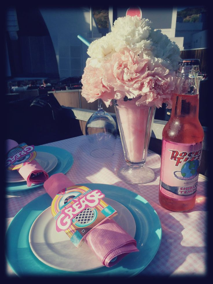 Grease themed party with milkshake floral arrangement. 50s party