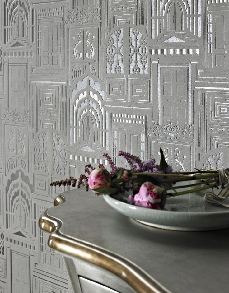 A beautiful true flock wallpaper design with ornate doors on a metallic background by Sophie Conran.