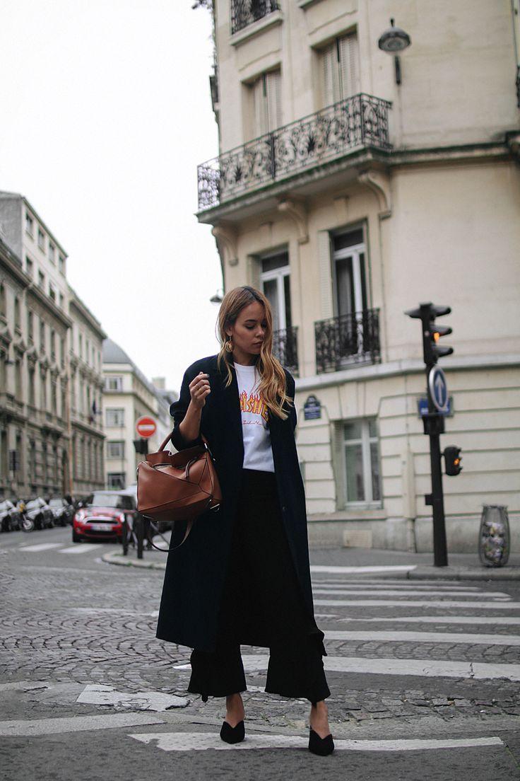 Outfit: With Frills and Mules in Paris. Desi is wearing Prada mules, Loewe bag, Thrasher shirt, Zara frill pants, H&M earrings - teetharejade.com