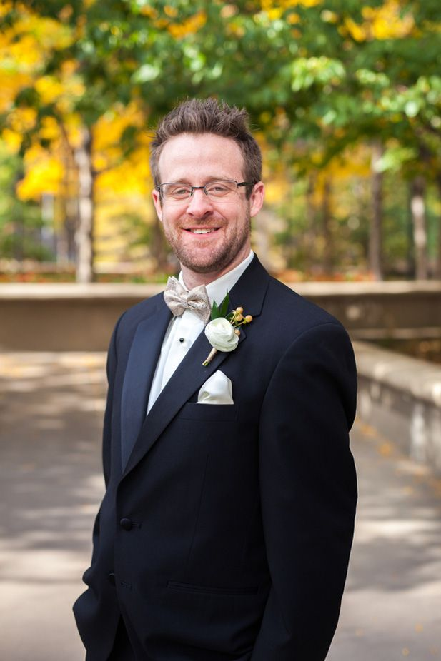 Black tux and gold bow tie for an elegant city wedding