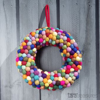 Add a pop of colour to your door or living area with this colourful felt wreath. Celebrate the holiday season with a handcrafted delight.